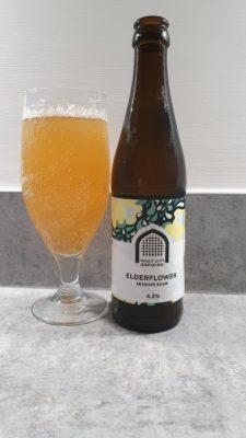 Elderflower sour bottle and pour